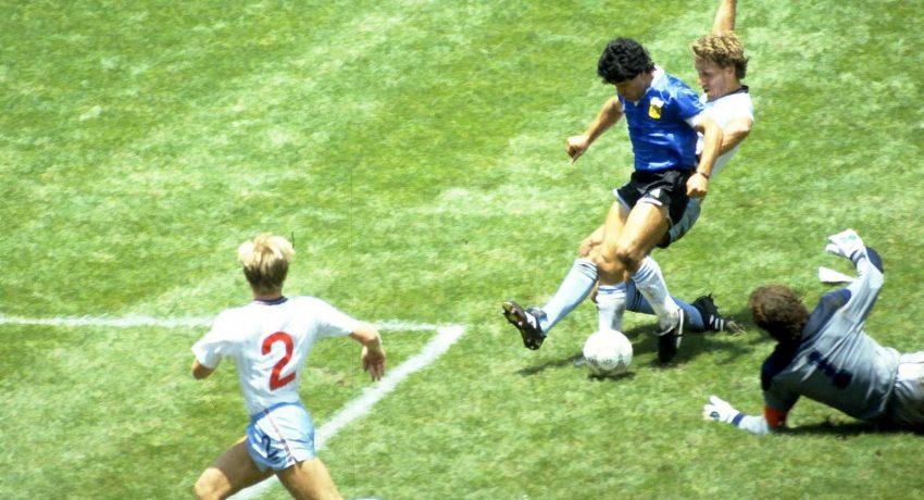 FILE PHOTO: Football - 1986 FIFA World Cup - Quarter Final - England v  Argentina - Azteca Stadium, Mexico City - 22/6/86   Diego Maradona scores for Argentina.  Action Images via Reuters/Juha Tamminen/File Photo