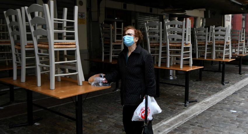 A woman stands outside a closed restaurant, amid the coronavirus disease (COVID-19) pandemic, in Thessaloniki, Greece, October 30, 2020. REUTERS/Alexandros Avramidis