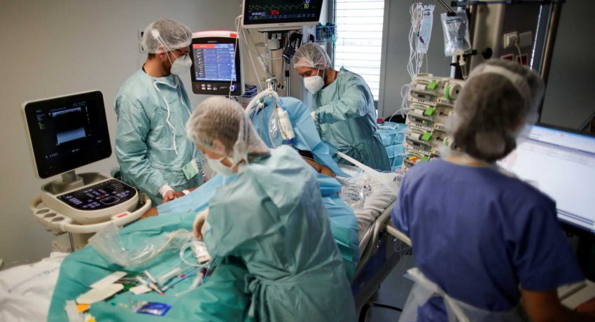 Medical staff members work in the Intensive Care Unit (ICU) where patients suffering from the coronavirus disease (COVID-19) are treated at the Melun-Senart hospital, near Paris, France, October 30, 2020. REUTERS/Benoit Tessier