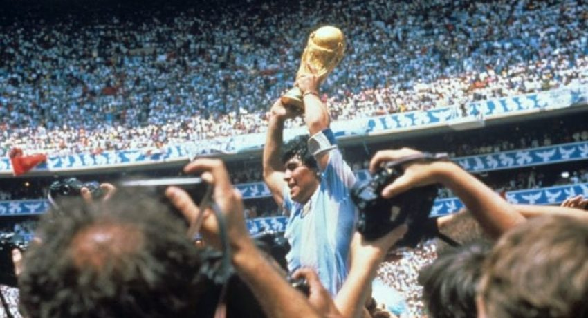 epa08841584 (FILE) - Argentinian soccer legend Diego Armando Maradona lifts the FIFA World Cup trophy after defeating Germany at the Azteca stadium in Mexico City, Mexico, 29 June 1986 (re-issued on 25 November 2020). Diego Maradona has died after a heart attack, media reports claimed on 25 November 2020.  EPA/EFE