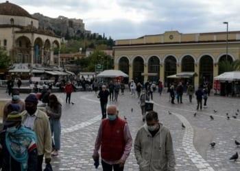 People wearing protective face masks make their way through the Monastiraki square amid the spread of the coronavirus disease (COVID-19) in Athens, Greece, November 6, 2020. REUTERS/Louiza Vradi