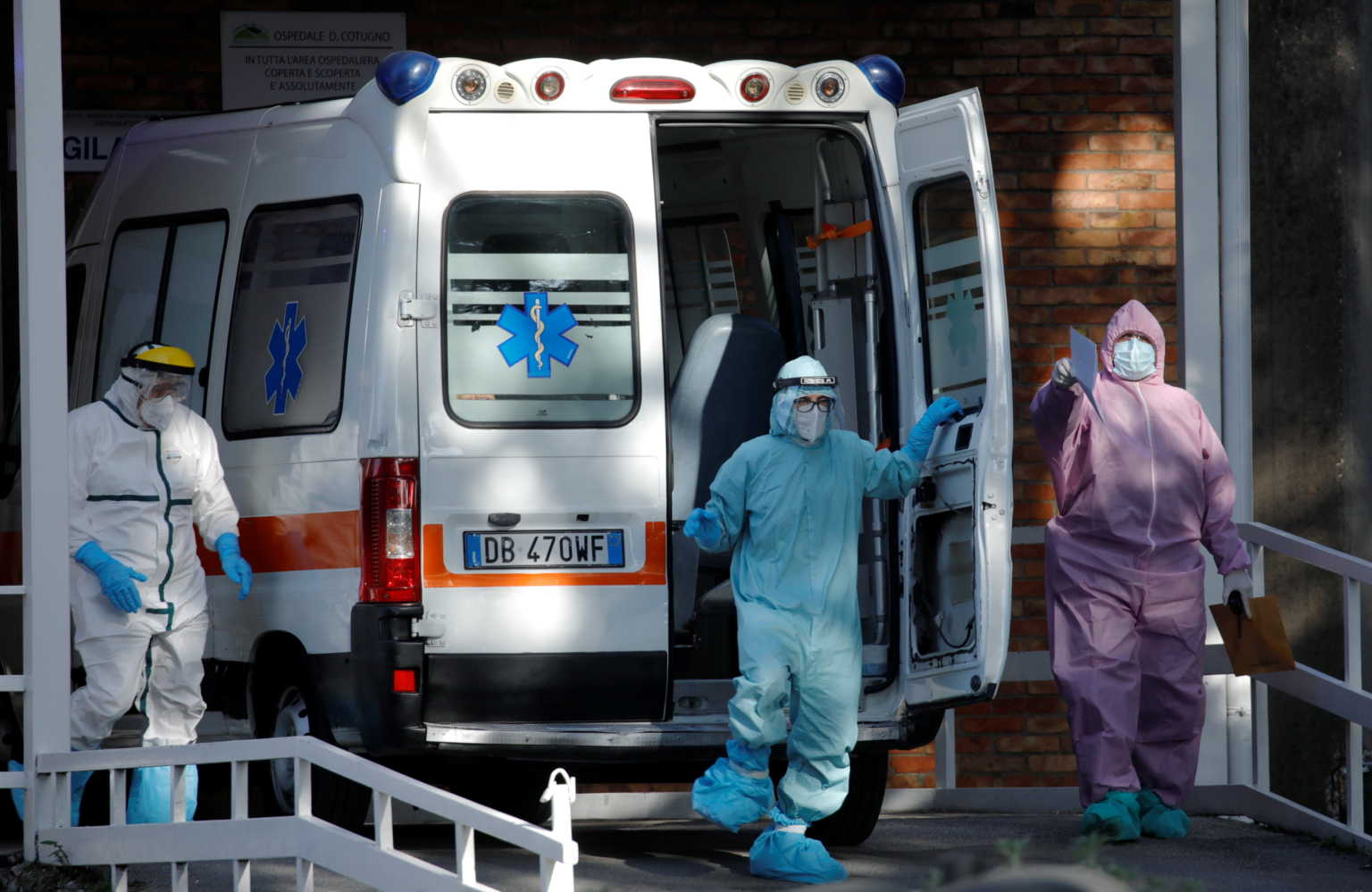 Medical workers wearing personal protective equipment (PPE) are seen next to an ambulance outside the Cotugno hospital as the battle with the coronavirus disease (COVID-19) intensifies, in Naples, Italy, November 9, 2020. REUTERS/Ciro De Luca