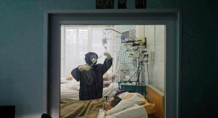 A medical specialist wearing protective gear takes care of a patient at the intensive care unit of the Vologda City Hospital Number 1, where patients suffering from the coronavirus disease (COVID-19) are treated, in Vologda, Russia November 24, 2020. REUTERS/Anton Vaganov