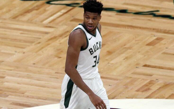 Milwaukee Bucks' Giannis Antetokounmpo plays against the Boston Celtics during the first half of an NBA basketball game, Wednesday, Dec. 23, 2020, in Boston. (AP Photo/Michael Dwyer)