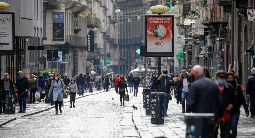 People wearing protective masks walk in the street as the region of Campania becomes a 'red zone', as part of tougher measures to tackle the spread of the coronavirus disease (COVID-19), in Naples, Italy November 16, 2020. REUTERS/Ciro De Luca