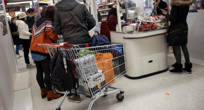 People shop at a Sainsbury's store, amid the coronavirus disease (COVID-19) outbreak, in London, Britain December 21, 2020. REUTERS/Hannah McKay