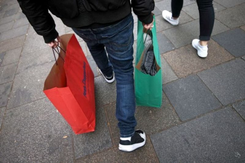 A person carries shopping bags as the Austrian government is due to announce a lockdown including the closure of all non-essential shops, as the spread of the coronavirus disease (COVID-19) continues, in Vienna, Austria November 14, 2020. REUTERS/Lisi Niesner