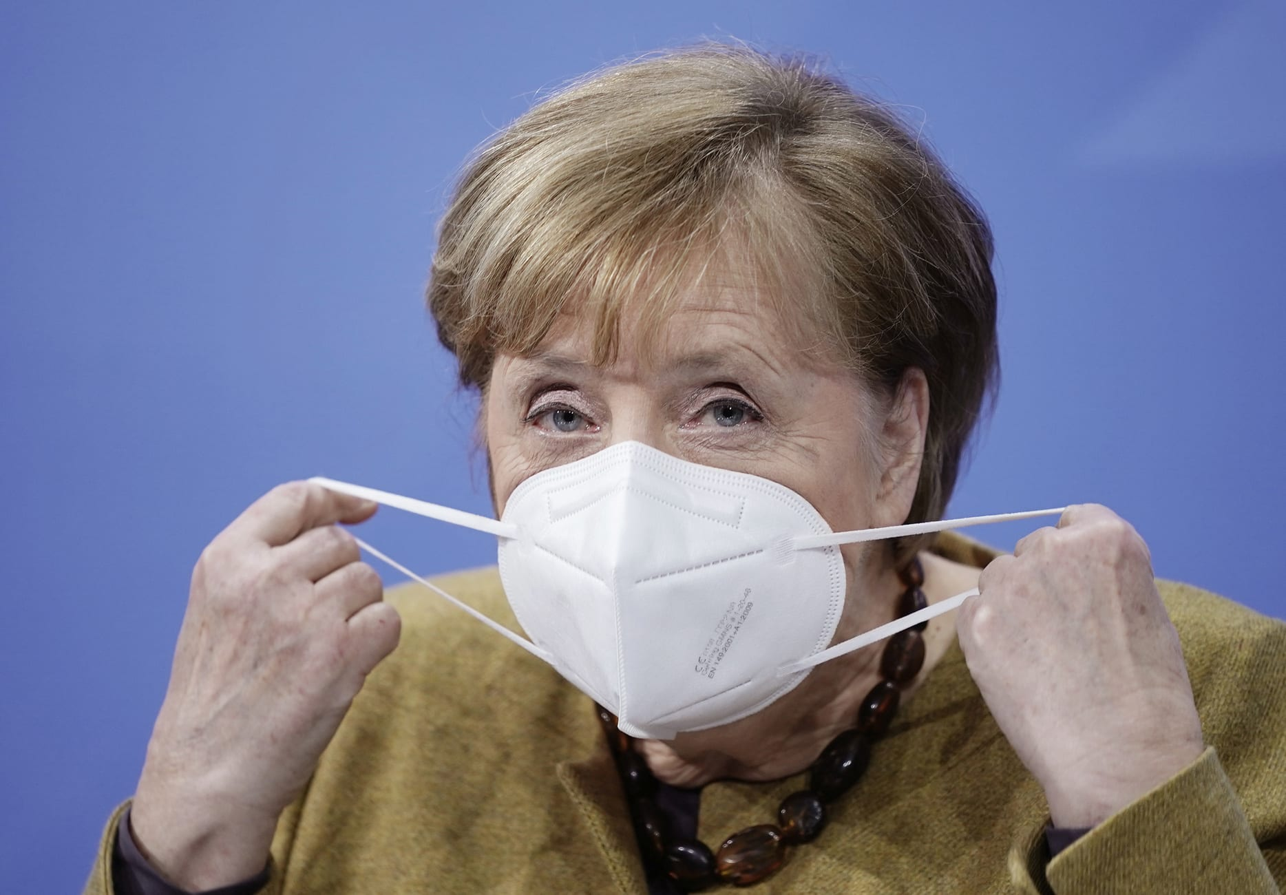 German Chancellor Angela Merkel wears a protective mask as she arrives for a news conference after talks with state leaders at the Chancellery in Berlin, Germany January 5, 2021.     Michel Kappeler/Pool via REUTERS