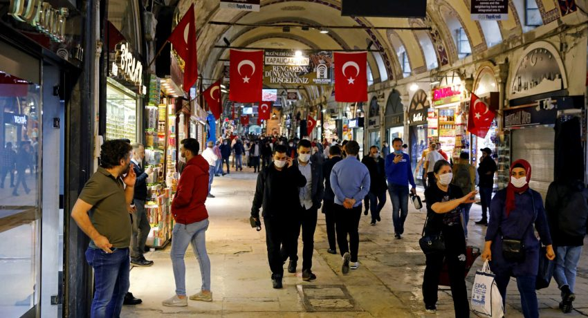 FILE PHOTO: People wearing protective face masks walk at Grand Bazaar as it reopens after weeks of the close doors amid the spread of the coronavirus disease (COVID-19), in Istanbul, Turkey, June 1, 2020. REUTERS/Umit Bektas/File Photo