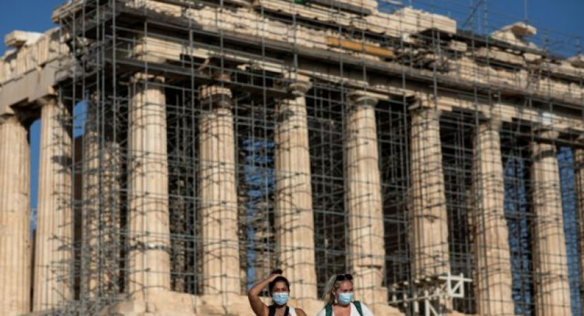 Two women wearing protective face masks amid COVID-19 pandemic visit the Parthenon temple atop the Acropolis hill in Athens, Greece, June 8, 2021. Picture taken June 8, 2021. REUTERS/Alkis Konstantinidis