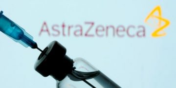 FILE PHOTO: A vial and sryinge are seen in front of a displayed AstraZeneca logo in this illustration taken January 11, 2021. REUTERS/Dado Ruvic/Illustration/File Photo