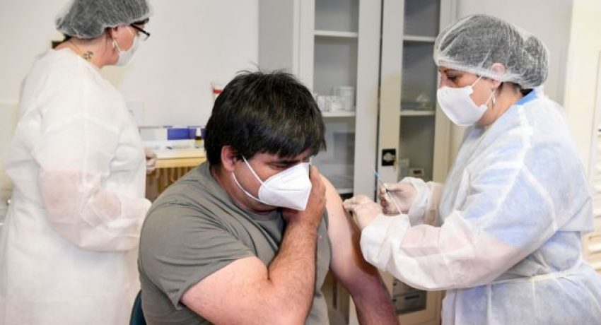 FILE PHOTO: A man receives a dose of the Sputnik V vaccine against the coronavirus disease (COVID-19) at a vaccination centre in Zilina, Slovakia June 7, 2021. REUTERS/Radovan Stoklasa/File Photo