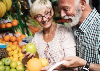 Portrait of beautiful elderly couple in market