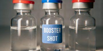 Booster shot covid-19 vaccine concept