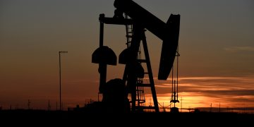 FILE PHOTO: A pump jack operates at sunset in an oil field in Midland, Texas U.S. August 22, 2018. Picture taken August 22, 2018. REUTERS/Nick Oxford/File Photo